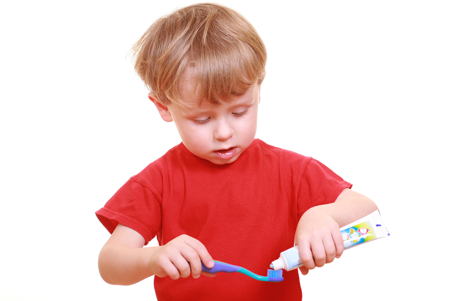 Child preparing to brush his teeth.